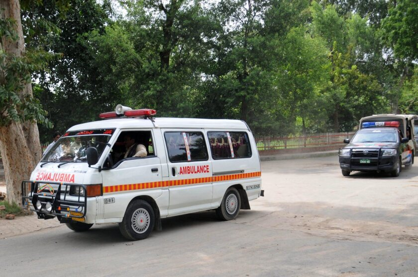 An ambulance carries the body of Malik Ishaq, a leader of the banned Lashkar-e-Jhangvi, after he was killed in Punjab province on Wednesday.