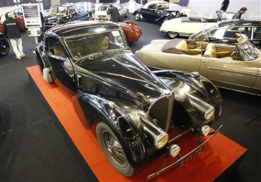 The 1937 Bugatti Type 57S Atalante Coupe, originally the property of Francis Curzon, the 5th Earl Howe, is seen displayed at the Retromobile Vintage Cars show in Paris, Friday, Feb. 6, 2009. The Bugatti is to be auctioned by Bonhams within the show on Saturday. (AP Photo/Thibault Camus)