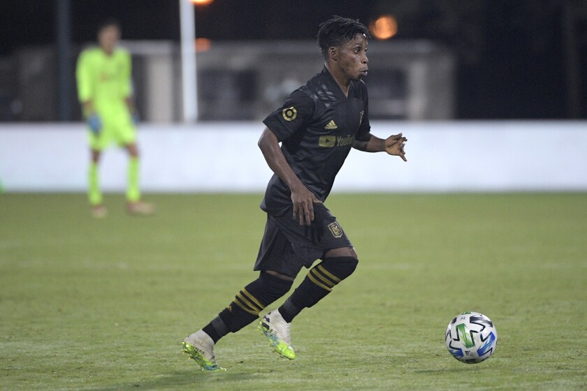 LAFC forward Latif Blessing controls a ball during the second half against the Portland Timbers.