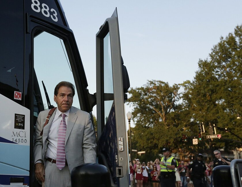 Alabama coach Nick Saban walks off the bus before Alabama's NCAA college football game against Mississippi, Saturday, Sept. 19, 2015, in Tuscaloosa, Ala. (AP Photo/Brynn Anderson)