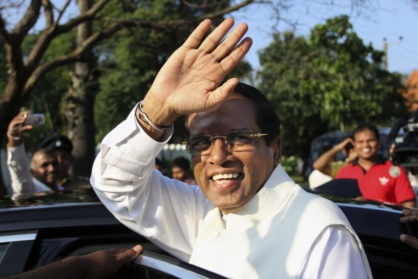 Sri Lanka's main opposition presidential candidate, Maithripala Sirisena, gestures Thursday after casting his vote at a polling station in Polonnaruwa, about 120 miles northeast of Colombo, the capital.