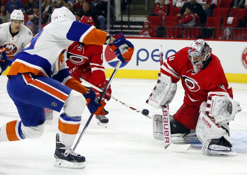 New York Islanders' Brock Nelson (29) fires the puck at Carolina Hurricanes goalie Cam Ward (30) during the first period of an NHL hockey game, Saturday, Feb. 13, 2016, in Raleigh, N.C. (AP Photo/Karl B DeBlaker)