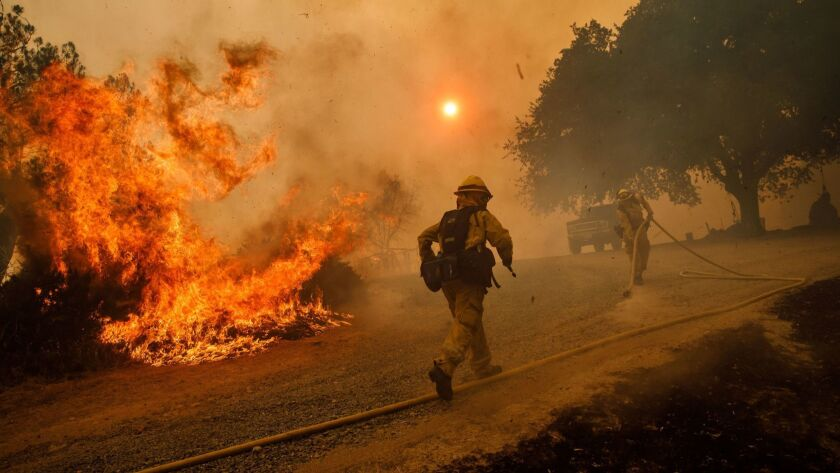 LAKEPORT, CALIF. -- TUESDAY, JULY 31, 2018: Firefighters work to keep flames from the River Fire fro