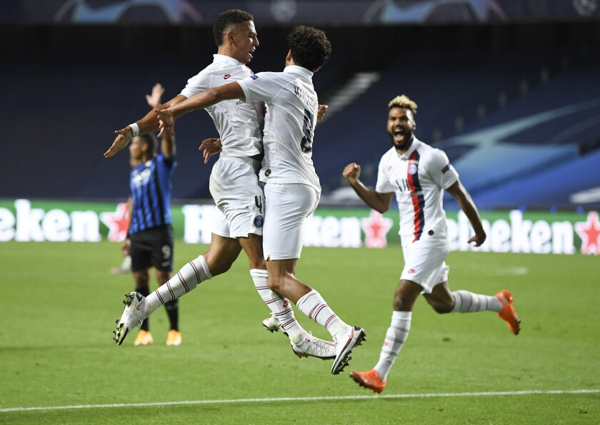 PSG's Marquinhos, centre, celebrates with teammate Thilo Kehrer, left, after scoring his team's first goal during the Champions League quarterfinal match between Atalanta and PSG at Luz stadium, Lisbon, Portugal, Wednesday, Aug. 12, 2020. (David Ramos/Pool Photo via AP)