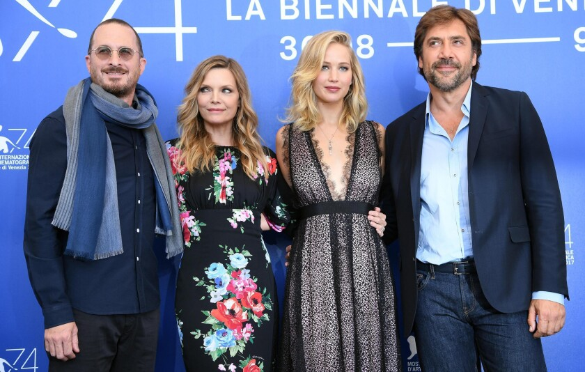 Darren Aronofsky, left, with Michelle Pfeiffer, Jennifer Lawrence and Javier Bardem.