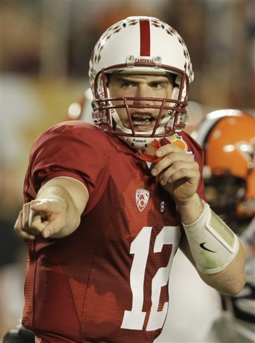 Stanford quarterback Andrew Luck calls a play during the second half of the Orange Bowl NCAA college football game, Monday, Jan. 3, 2011 in Miami. Luck went 18 for 23 and was chosen the Orange Bowl most valuable player. (AP Photo/Lynne Sladky)