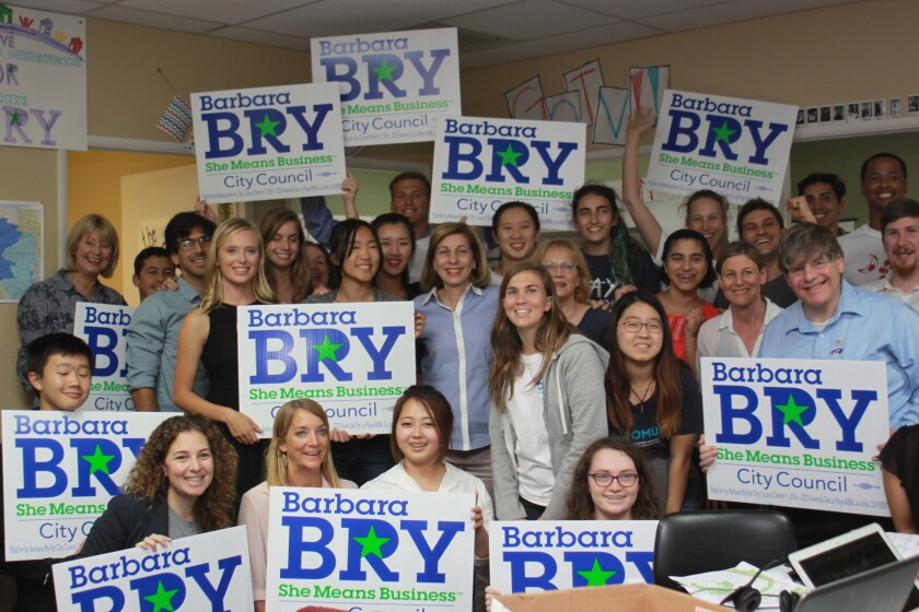 Dozens of high school and college students celebrate the win with District 1 City Councilmember-elect Barbara Bry of La Jolla.
