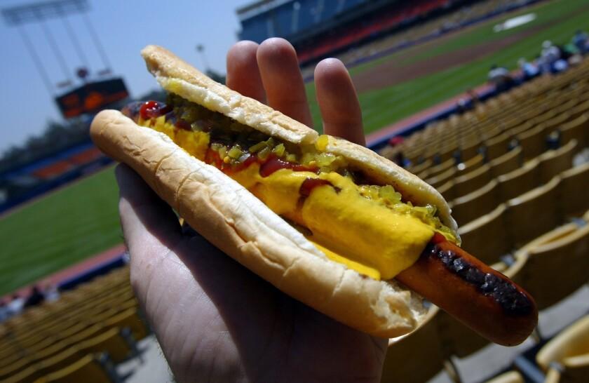 A Dodger Dog slathered in mustard, ketchup and relish at Dodger Stadium.