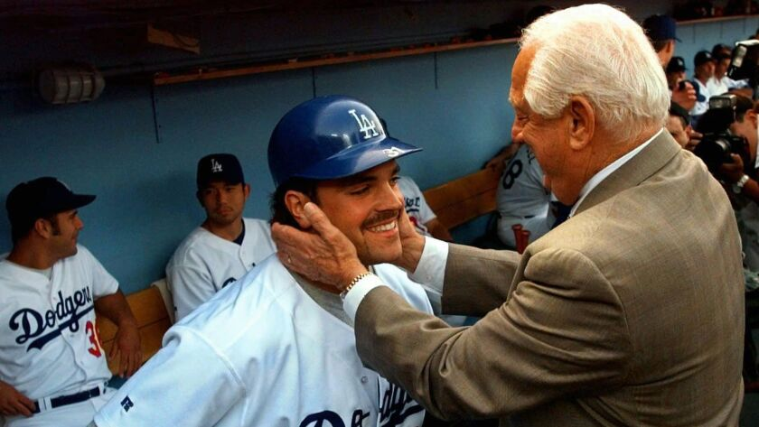 Former Dodgers catcher Mike Piazza made the Hall of Fame long after he was the 1,384th player picked in the 1987 draft, and only as a favor to family friend Tommy Lasorda (right).