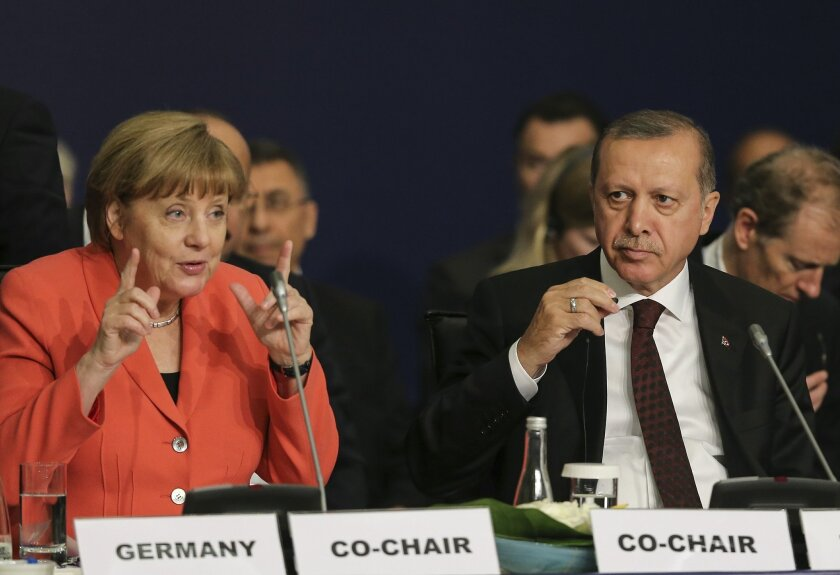 "German Chancellor Angela Merkel, left, talks as Turkey's President Recep Tayyip Erdogan listens during a roundtable meeting on ""Political Leadership to Prevent and End Conflicts"" at the World Humanitarian Summit in Istanbul, Monday, May 23, 2016. World leaders and representatives of humanitarian organisations from across the globe converge in Istanbul on May 23-24, 2016 for the first World Humanitarian Summit, focused on how to reform a system many judge broken. (Salih Zeki Fazlioglu/Anadolu, Pool Photo via AP)"