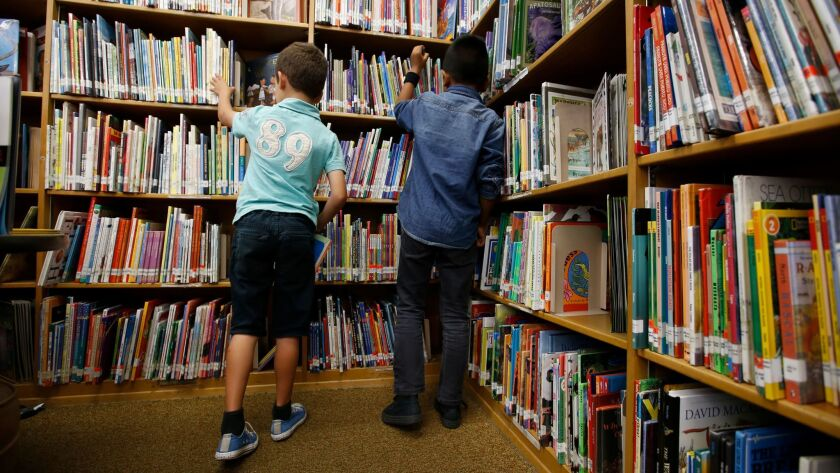 TORRANCE, CA MAY 4, 2017: Second graders Julian Gutierrez, 7, left, and Alex Sixtos, 8, right, eag