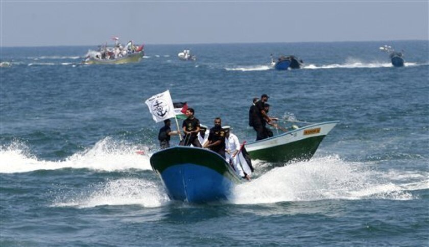 Hamas security officers patrol the Gaza waters a day before a flotilla of aid ships is expected to try and sail into the blockaded territory, in Gaza city, Sunday, May 30, 2010. Hundreds of pro-Palestinian activists on seven ships were to set sail for the Gaza Strip on Sunday from international wat