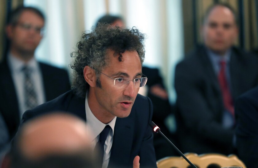 Alex Karp, chief executive of Palantir, speaks during a roundtable at the White House in June 2017.