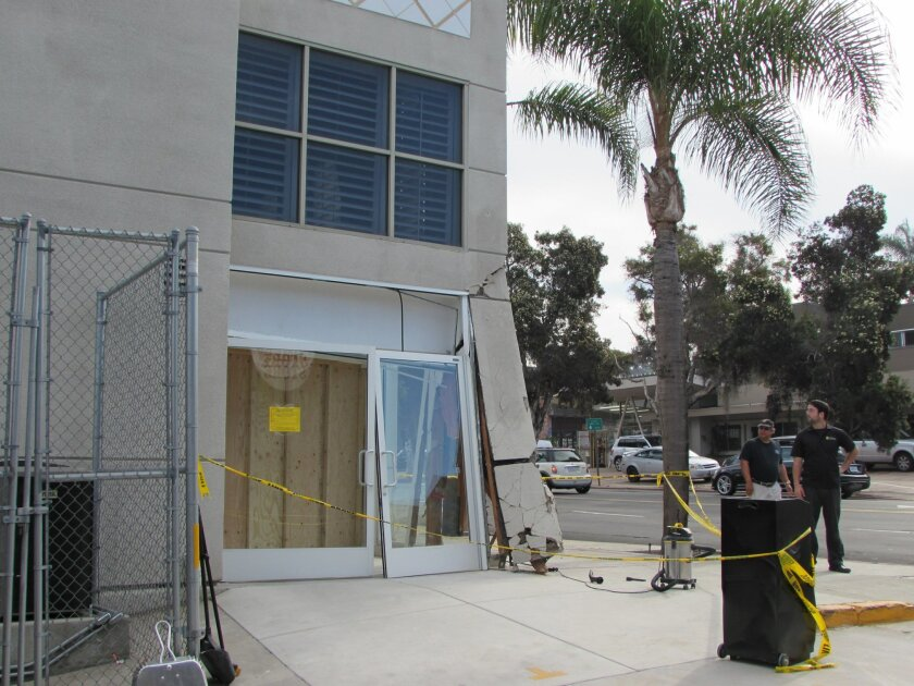 Damages to the Ferrari of San Diego showroom on Pearl Street in La Jolla after being struck by a rare luxury Fisker car.