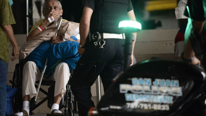 A patient waits to be evacuated from the San Francisco hospital after an electrical plant failure, i