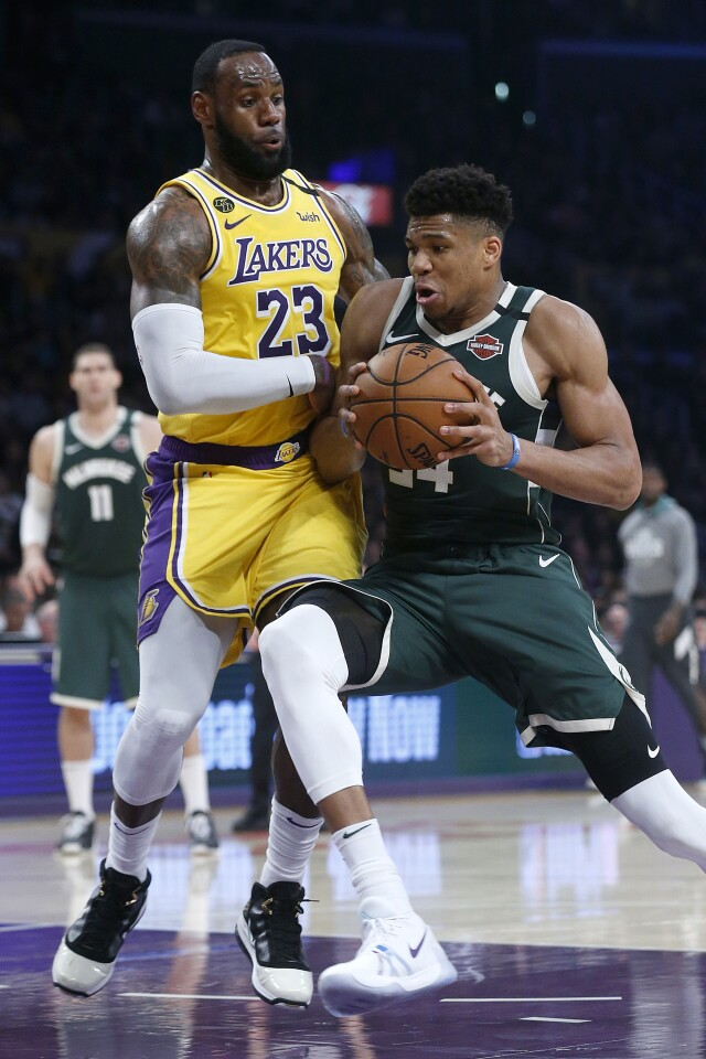 LOS ANGELES, CALIF. -- FRIDAY, MARCH 6, 2020: Los Angeles Lakers forward LeBron James (23) guards Milwaukee Bucks forward Giannis Antetokounmpo (34) causing him to lose possession of the ball to the Los Angeles Lakers in the first half at the Staples Center in Los Angeles, Calif., on March 6, 2020. (Gary Coronado / Los Angeles Times)