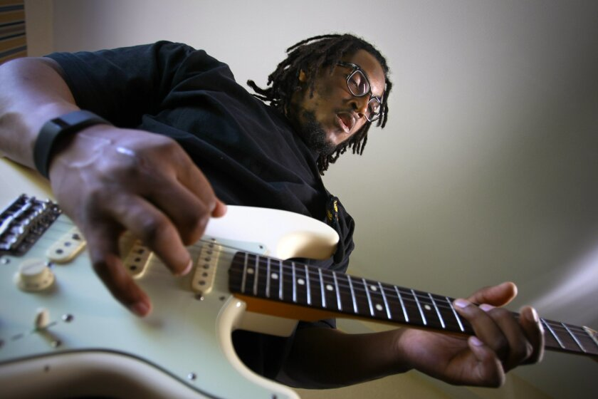 San Diego Chargers offensive lineman Joe Barksdale plays his Fender Stratocaster guitar in his free time at the hotel near Chargers Park in Murphy Canyon where he stayed during minicamp.