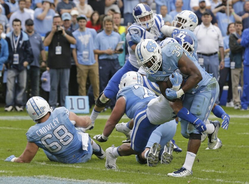 North Carolina's Elijah Hood (34) scores a touchdown against Duke during the first half of an NCAA college football game in Chapel Hill, N.C., Saturday, Nov. 7, 2015. (AP Photo/Gerry Broome)