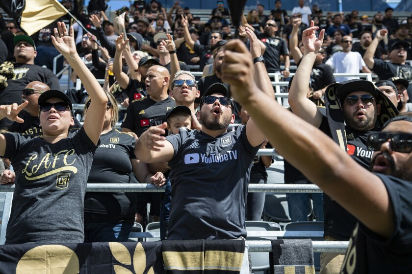 Fans go wild watching LAFC score against Montreal during a screening of the game at Banc of California Stadium on April 21.