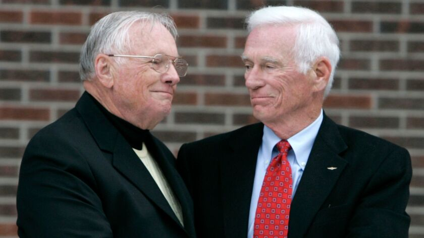Neil Armstrong, left, is congratulated by Gene Cernan following the dedication ceremony of the Neil Armstrong Hall of Engineering at Purdue University in West Lafayette, Ind. in 2007.