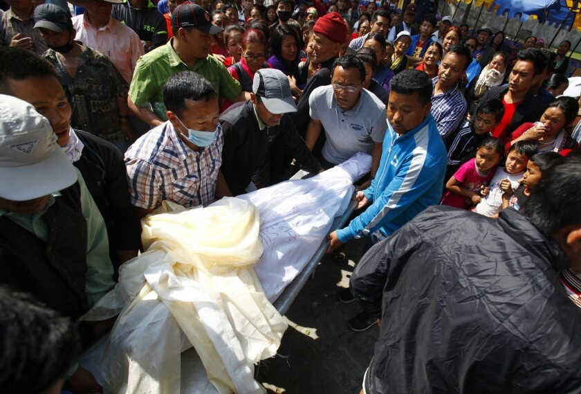 The body of Nepalese mountaineer Ang Kaji Sherpa, killed in an avalanche on Mount Everest, is carried to the Sherpa Monastery in Katmandu.