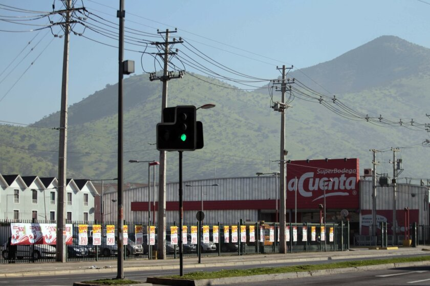This Sept. 3, 2015, photo shows Wal-Mart's no-frills SuperBodega aCuenta in Santiago, Chile. Chile is a bright spot in Wal-Mart's international business, which has become ever more important as growth in the U.S. has slowed. (AP Photo/Luis Hidalgo)