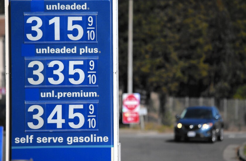 The average price for a gallon of regular gas in California has been fluctuating around $3.20 in March, nearly 80 cents more than the U.S. average. Above, prices are displayed at a gas station in Mill Valley, Calif., in early March.