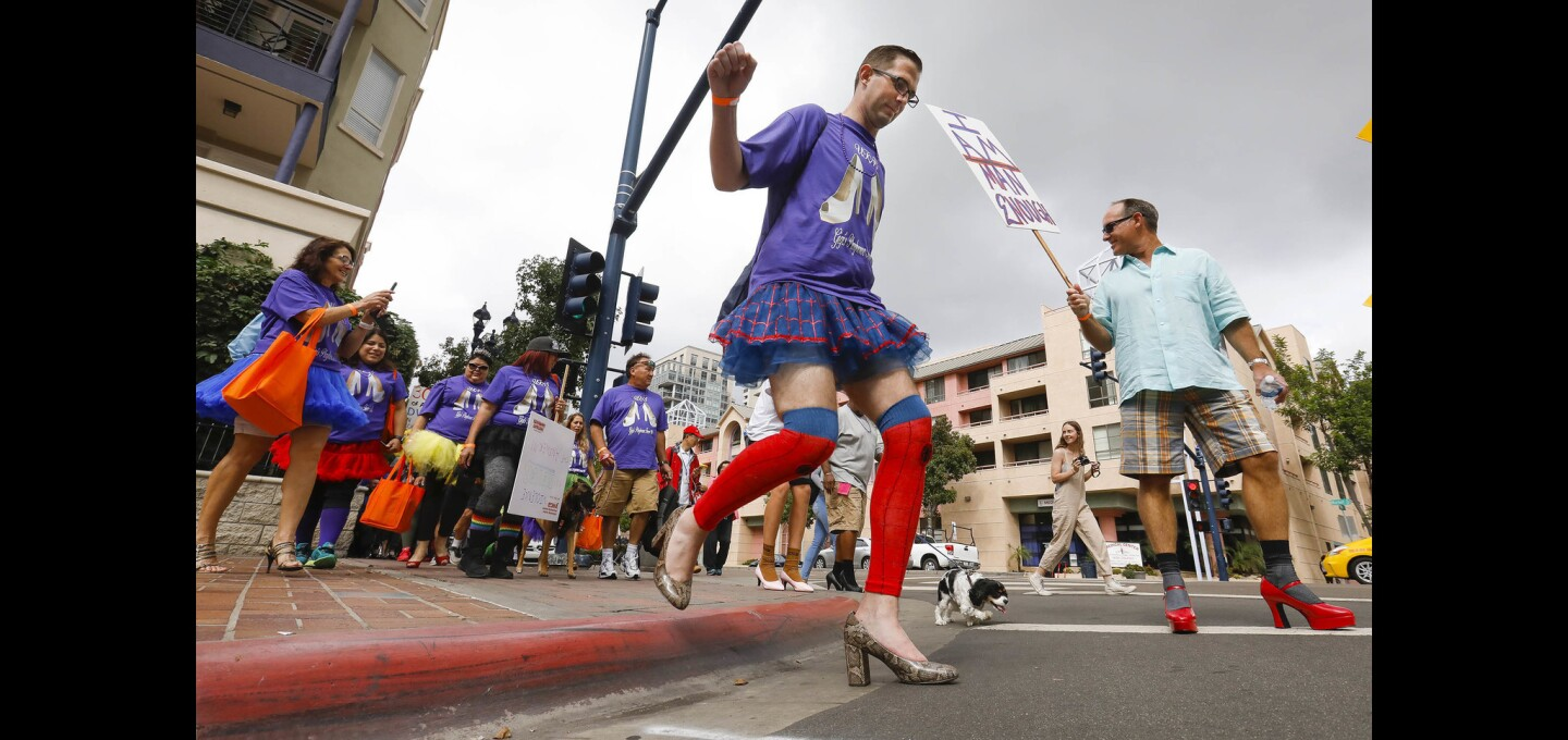 "Steve Wilson of La Mesa, sporting a tutu and high heels was one of a couple of hundred people, many of them men wearing women's high heel shoes to walk through the Gaslamp Quarter during the YWCA'S 11th annual ""Walk a Mile in Her Shoes,"" taking a stand against domestic violence."