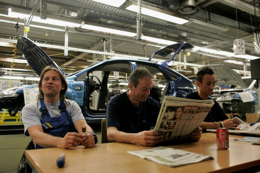 Employees pause at a Ford plant in Saarlouis, Germany.