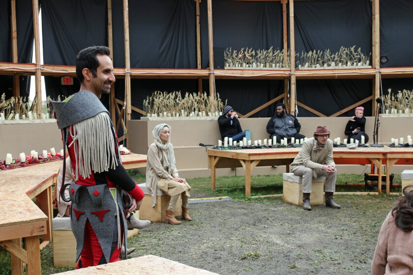 "Fahad Siadat, in costume as Brother, waits for video taping to begin on ""Sweet Land"""