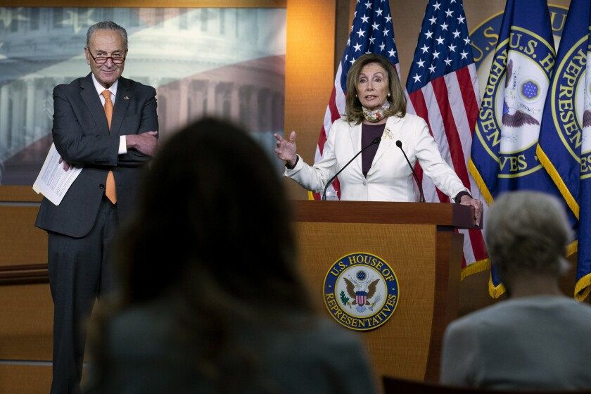 House Speaker Nancy Pelosi, with Senate Minority Leader Charles E. Schumer, speaks Aug. 6 at a Capitol Hill news conference.