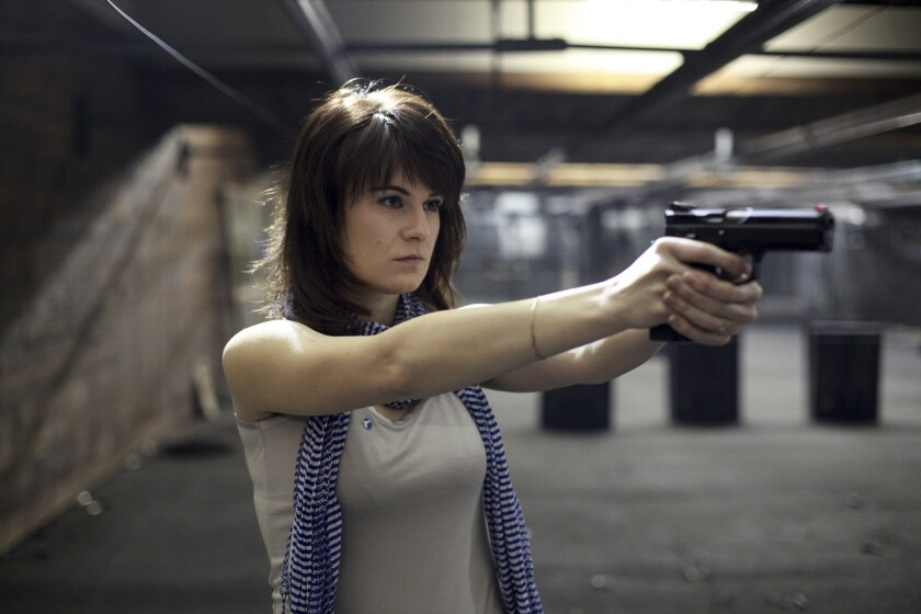 Maria Butina, a gun-rights activist and alleged Russian spy, poses for a photo at a shooting range in Moscow in 2014.