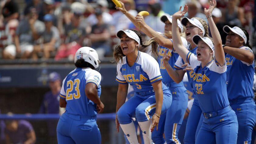 UCLA's celebrates Rachel Garcia three-run home run in the 10th inning against Washington during a Wo