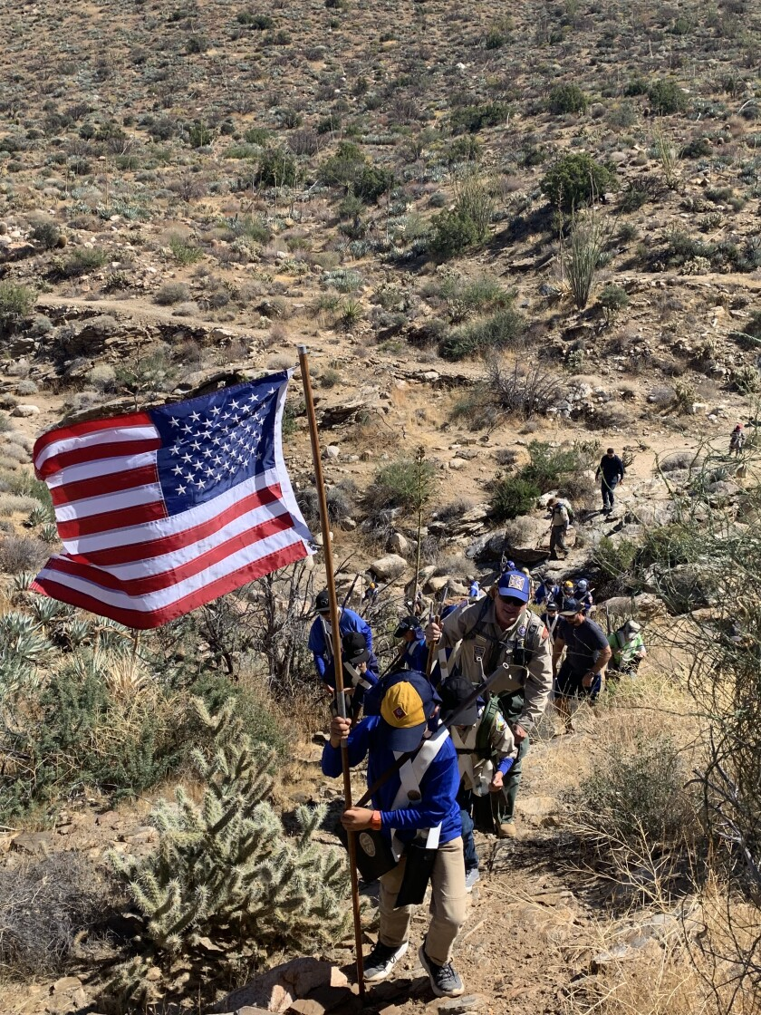 Cub Scouts climb uphill to a memorial site in Box Canyon on the Great Southern Overland Route of 1849 near Julian on Saturday, Oct. 19, during a five-mile hike re-creating a portion of the Mormon Battalion's march in the mid-1840s.