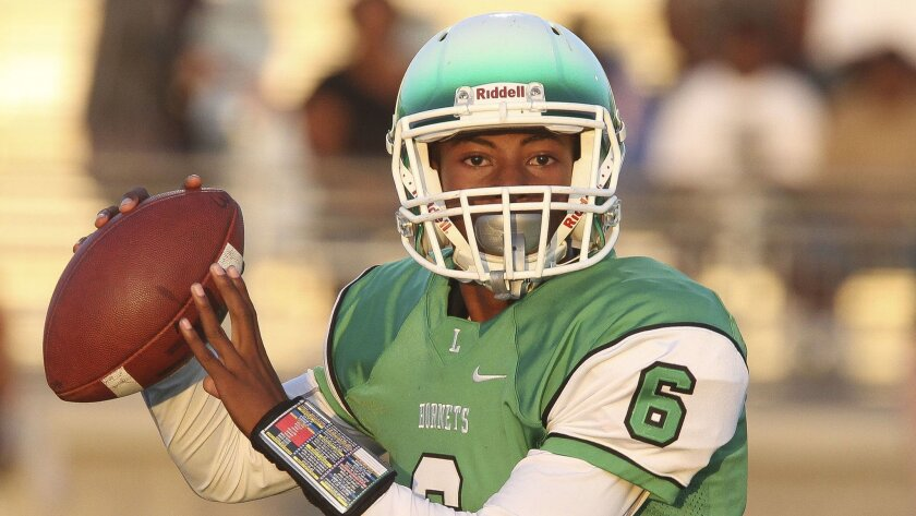 Lincoln quarterback Asante Hartzog threw six touchdown passes in the Hornets' win over Point Loma.