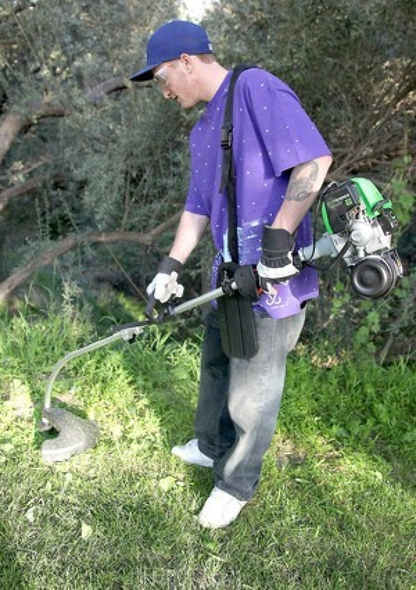 Compared to the typical two-stroke weed whacker, the propane-powered Lehr Eco Trimmer exhausts angel's breath.