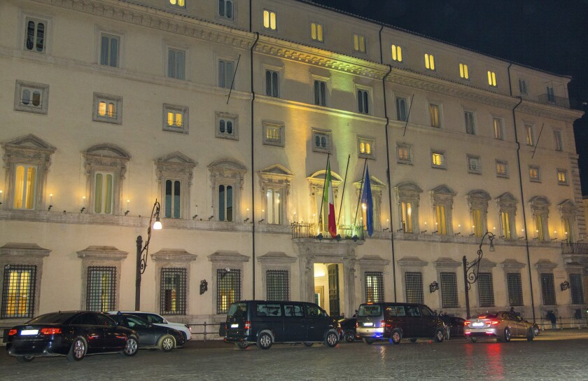 A motorcade allegedly carrying Libyan eastern-based forces General Khalifa Hifter leaves Italian Premier Giuseppe Conte's office in Rome, Wednesday, Jan. 8, 2020. Hifter traveled to Rome on Wednesday on a previously unannounced visit to meet with Italian Premier Giuseppe Conte. An Italian government spokesman, Rocco Casalino, said Serraj was expected to meet with Conte later in the evening. (AP Photo/Domenico Stinellis)
