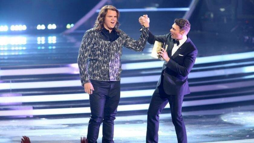 Ryan Seacrest, right, announces Caleb Johnson the winner at the American Idol XIII finale at the Nokia Theatre at L.A. Live on Wednesday, May 21, 2014, in Los Angeles. (Photo by Paul A. Hebert/Invision/AP) (/ The Associated Press)