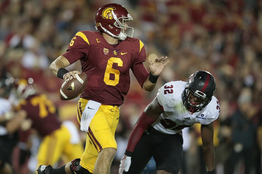 USC quarterback Cody Kessler is chased by Arkansas State linebacker Tajhea Chambers in the first quarter of their season opener on Sept. 5 at the Coliseum.