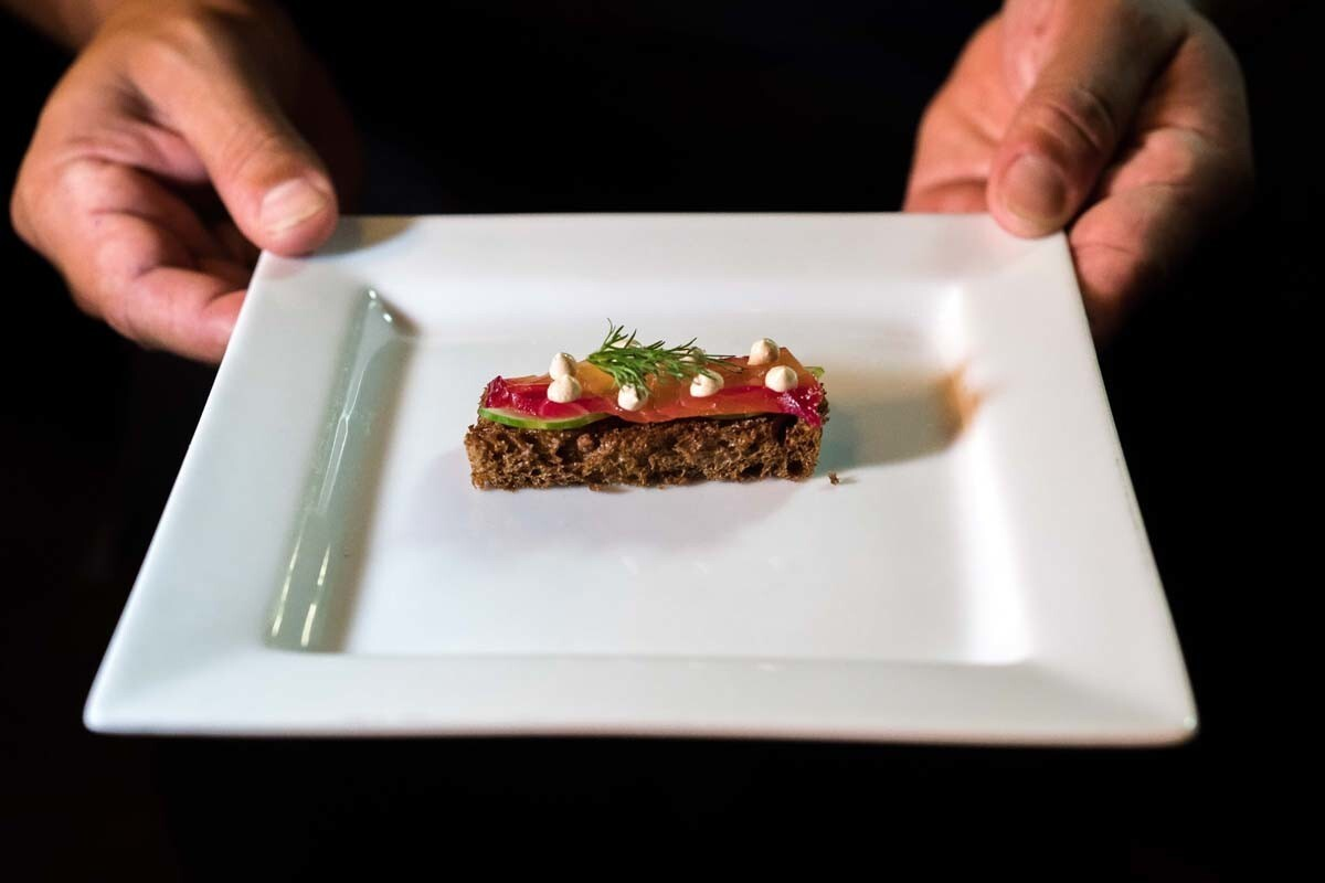 """On Sept. 2, 2017, Chef Steve Brown hosted a multi-course dinner titled """"A Beautiful Contradiction"""" at Temp by Cosecha in Chula Vista. Pictured is the beet cured salmon, smoked cream cheese and multigrain toast seventh course. (Jim Sullivan)"""
