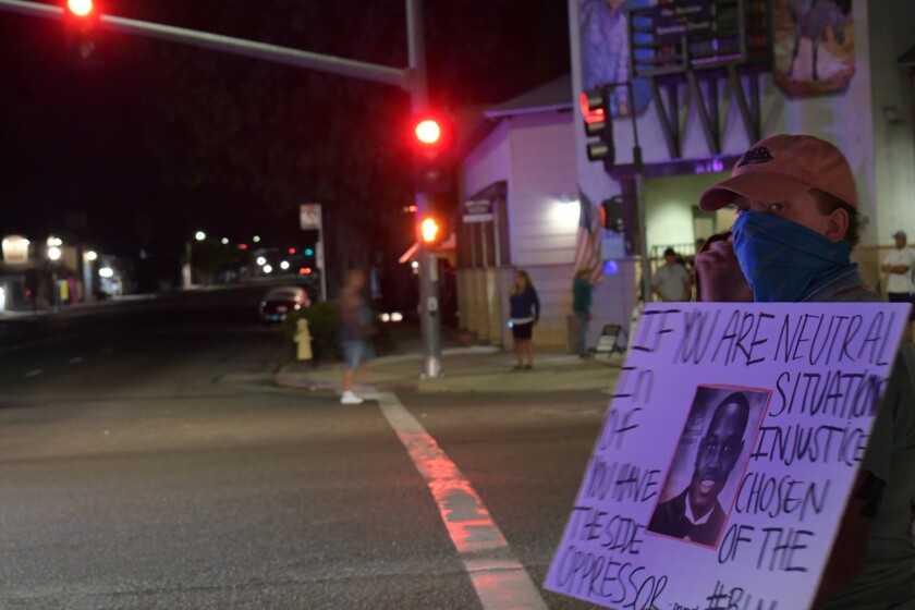 Black Lives Matter protesters in Ramona held signs decrying racism.