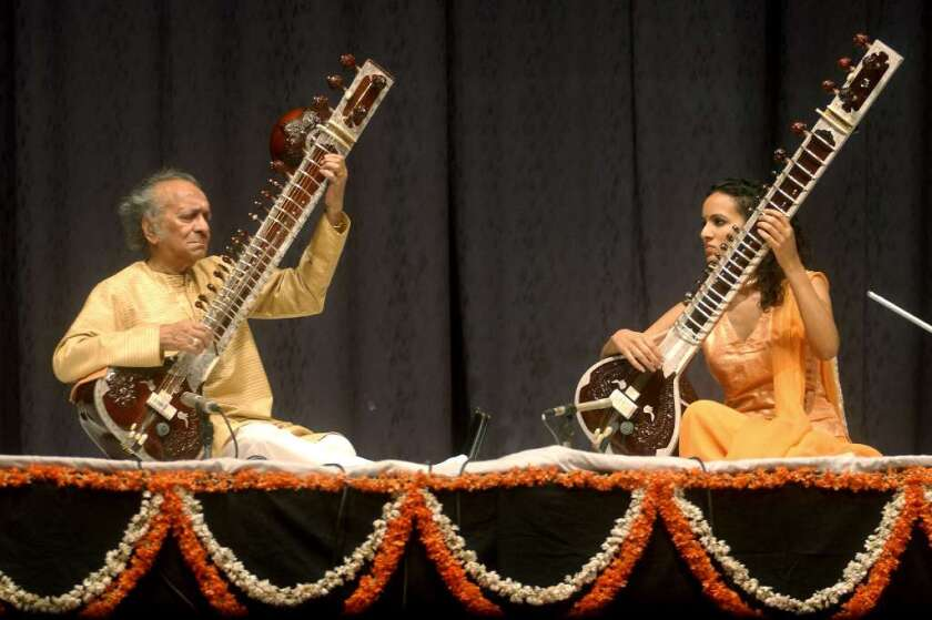 Ravi and Anoushka Shankar perform at a 2004 tribute concert in London honoring former Beatle George Harrison, who was a longtime friend and student of Ravi Shankar.