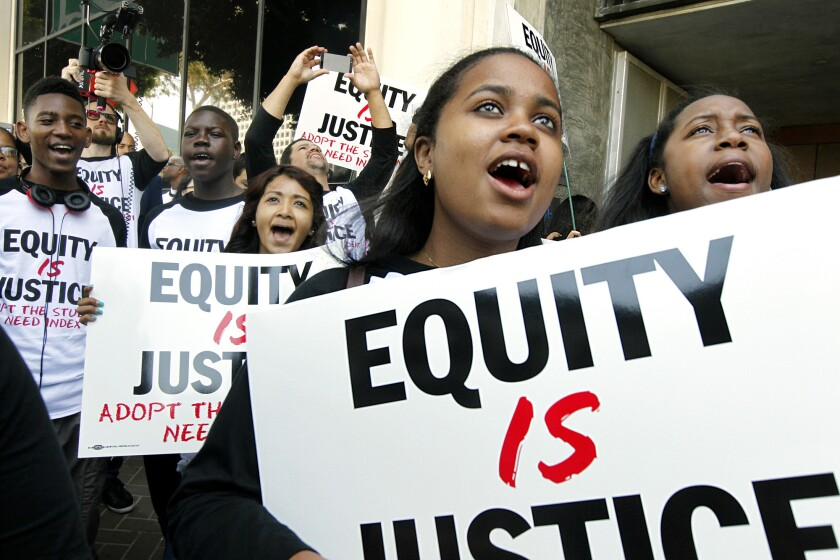 Students rally in support of the Equity Is Justice Resolution, which would send millions of dollars in new education funds to schools in the L.A. Unified School District in the highest need. The LAUSD was sued Wednesday for allegedly shortchanging high-needs students of millions of state funds.