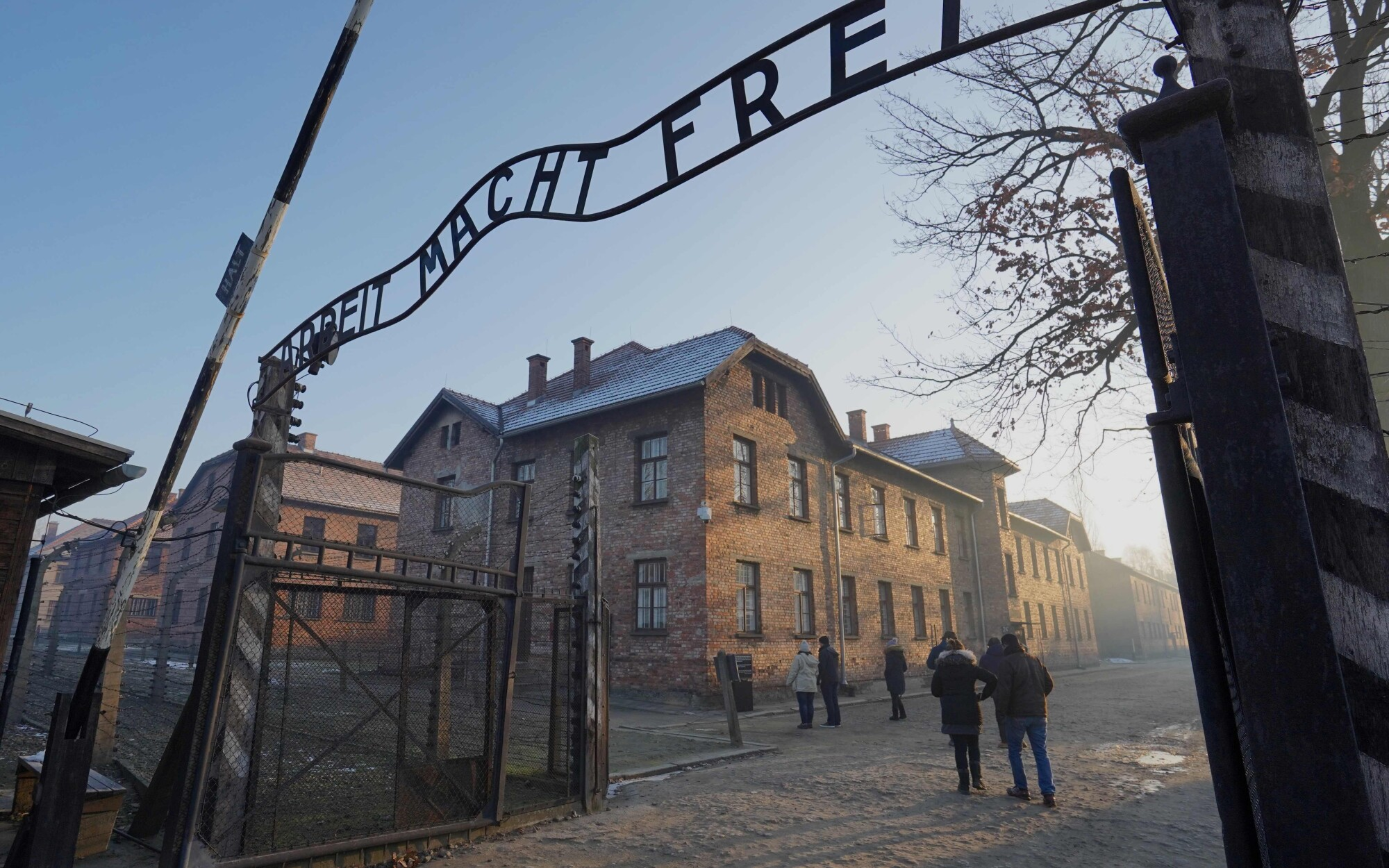 "The main gate with the inscription of ""Arbeit macht frei"" (""Work sets you free"") at the entrance to Auschwitz."