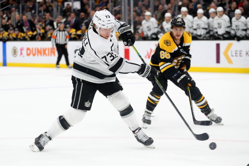 The Kings' Tyler Toffoli (73) battles the Bruins' David Pastrnak on Dec. 17 in Boston.