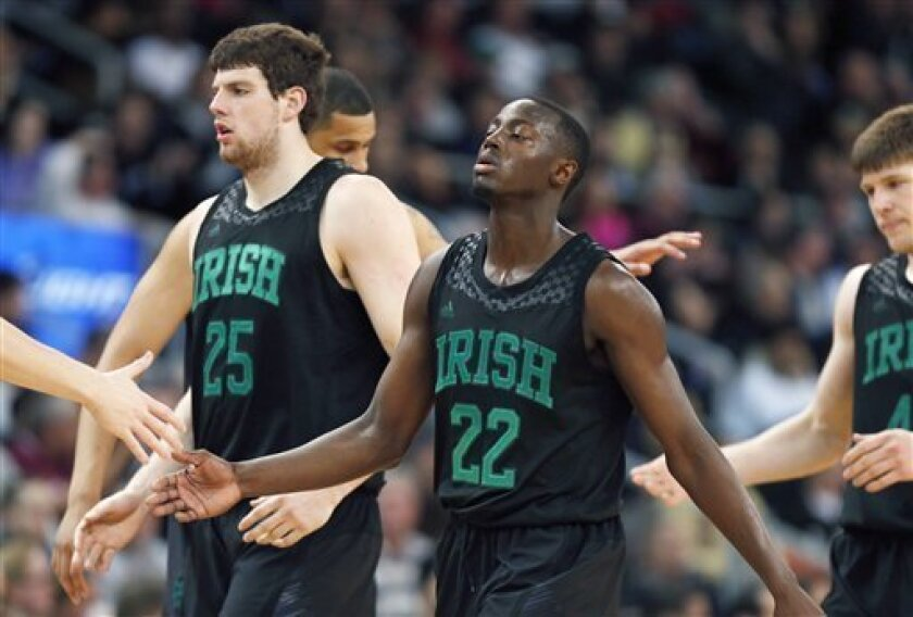 Notre Dame's Tom Knight (25), Jerian Grant (22) and Jack Cooley, right, walk to the bench during a timeout in the second half of an NCAA college basketball game against Providence in Providence, R.I., Saturday, Feb. 16, 2013. Providence won 71-54. (AP Photo/Michael Dwyer)