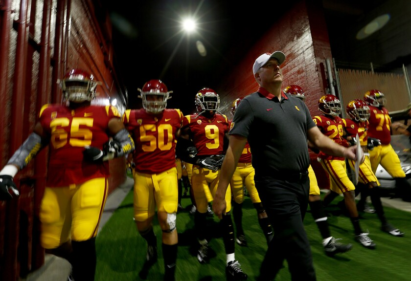 USC coach Clay Helton leads the Trojans down the tunnel before their game against Oregon at the Coliseum.