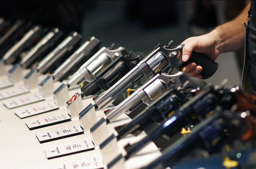 Handguns are displayed at a booth at the Shooting, Hunting and Outdoor Trade Show in Las Vegas in 2016.