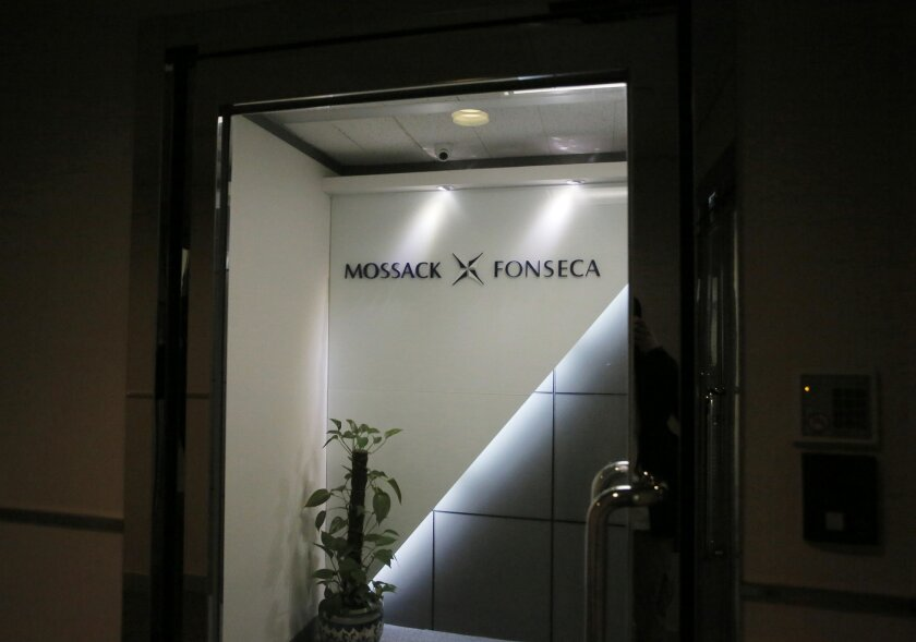 FILE - This April 5, 2016 file photo shows the entrance of the regional head office of Panama-based law firm Mossack Fonseca, one of the world's biggest creators of shell companies, in Hong Kong,  America's openness to foreign tax evaders is coming under new scrutiny after the leak this week of 11.
