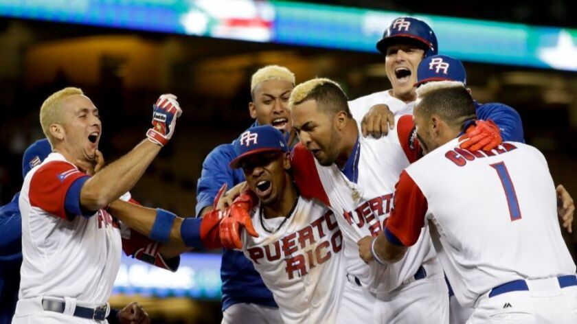Puerto Rico team members celebrate their win over the Netherlands in a World Baseball Classic semifinal at Dodger Stadium on March 20.